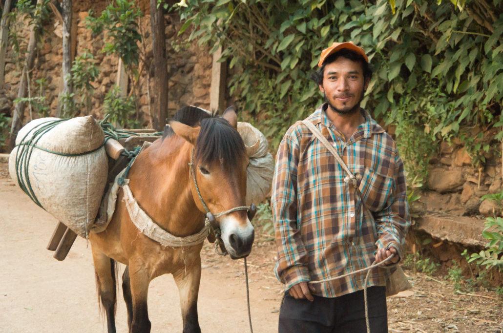 Man Returning to Village with Coffee on Horseback